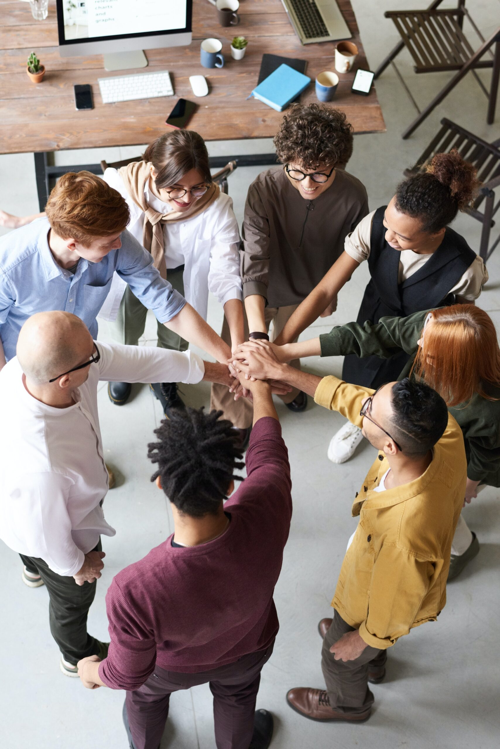 People in a team building circle